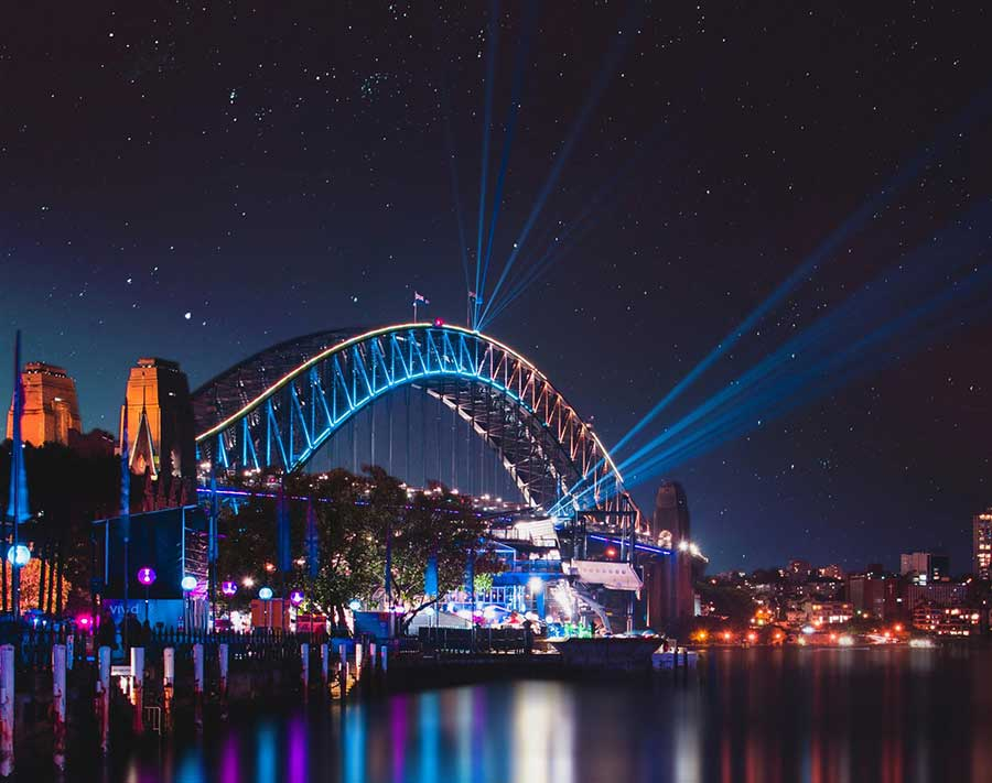 a beautiful view of the sydney bridge at night