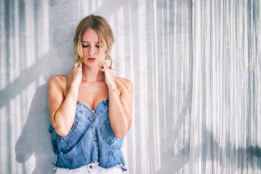 Sydney escort poses wearing a denim top